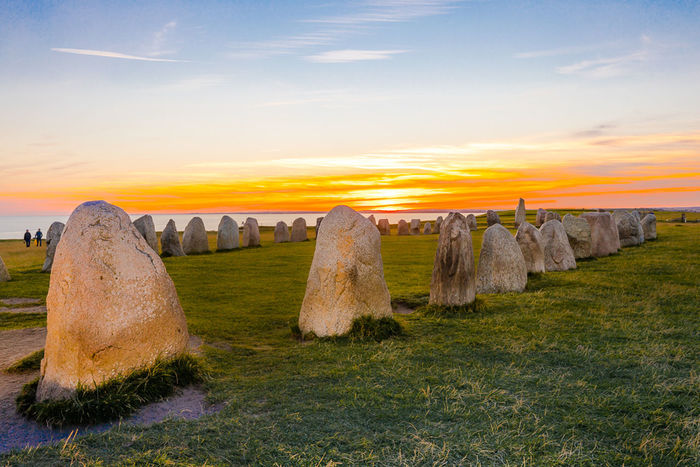 Ales Stenar Sweden Beauty In Nature Day Grass Land Art Landscape Nature No People Outdoors Sky Stone Sunset Travel Destinations Connected By Travel Connected By Travel