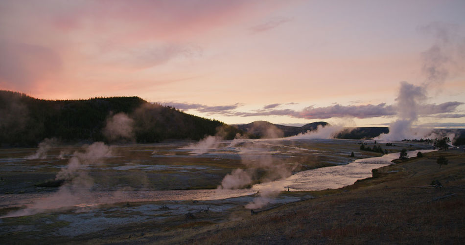 Sky Scenics - Nature Smoke - Physical Structure Geology Environment Water Sunset Landscape Power In Nature Geyser Erupting Beauty In Nature Nature Steam Heat - Temperature No People Non-urban Scene Hot Spring Mountain Emitting Outdoors Pollution Air Pollution