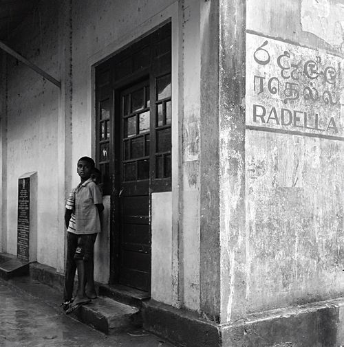 Raining in Radella Architecture Casual Clothing Built Structure Building Exterior Day Train Station Raining Shelter Blackandwhite Gloomy Children Young People Photography Sri Lanka Monsoonseason