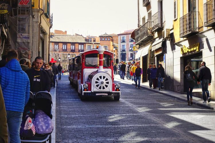 Tour Vintage Old Town Europe Tourism Tourist Attraction  Tourist Train Toledo SPAIN Zocodover Starting A Trip People People Watching City Men Land Vehicle City Life Road Street City Street Women Architecture Sky Passenger Train Train - Vehicle Public Transportation