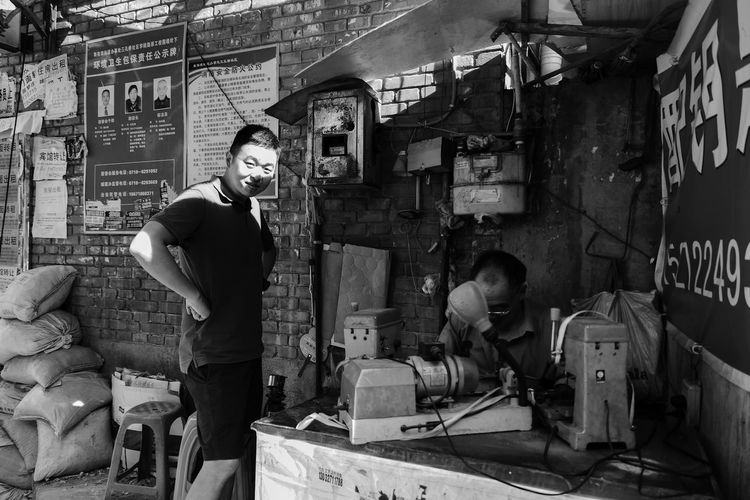 Monochrome Black And White Blackandwhite Real People Standing Looking At Camera Portrait Young Adult Occupation The Street Photographer - 2018 EyeEm Awards Working Men Casual Clothing Lifestyles Adult