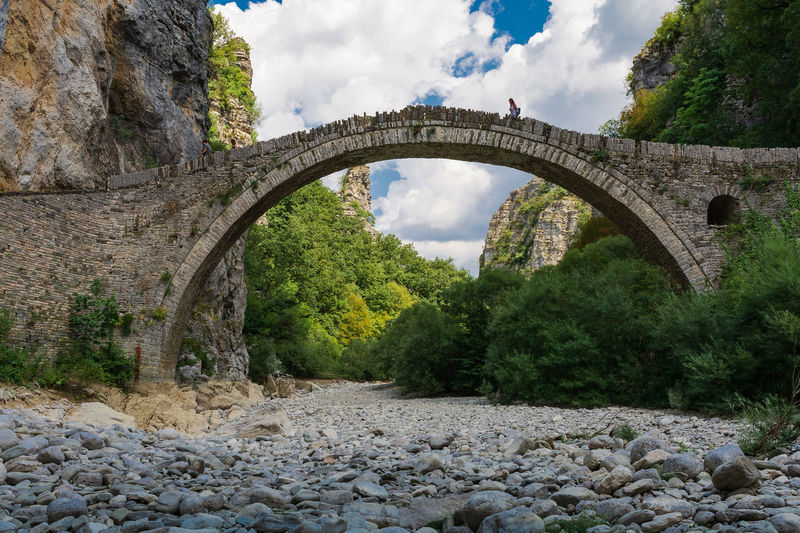 Bridge of Kokkori Arch Arch Bridge Arched Architecture Bridge Bridge - Man Made Structure Built Structure Cloud - Sky Connection Day Greece Growth Nature No People Outdoors Plant Rock Rock - Object Sky Solid Stone Wall Transportation Tree Water Zagori
