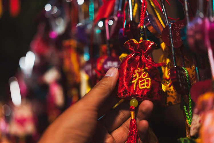 Blessing, wishing, Chinese culture China Landscape Blessing Wishing Chinese Culture Night Human Hand Focus On Foreground Hand Human Body Part Close-up Decoration Real People One Person Red Lifestyles Hanging Celebration Illuminated Finger