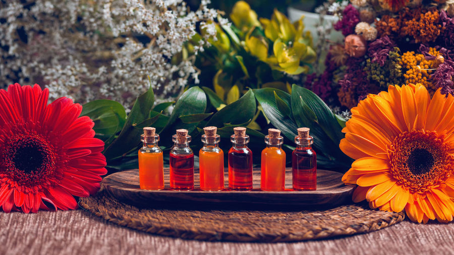 Aromatherapy Aromatherapy Aromatherapy Oil Essential Oils Orange Red Bottles Spa Wellness Relax Glass Therapy Blue Natural Aromatic Brown Care Treatment Healthy Perfume Candles Essence Green Fragnance Organic Health Aroma Fresh Alternative Relaxation Lifestyle Decoration Cosmetic Ingredient Skincare No People Close-up Bottle Table 16x9 Flower Freshness Fragility
