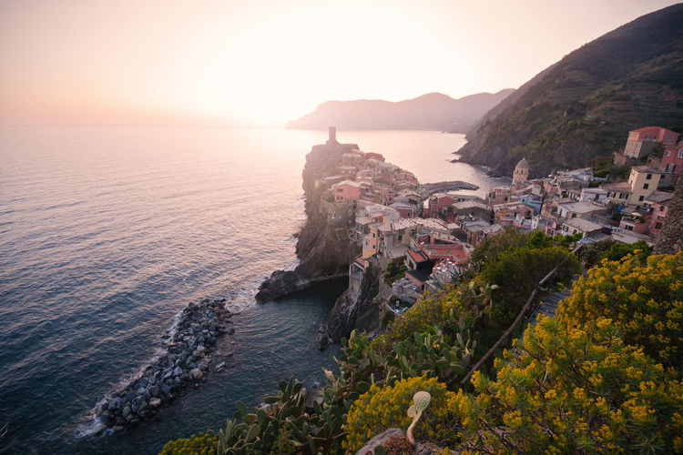 Vernazza (Cinque Terre, Liguria, Italy) at sunset. High angle of view. Vernazza Vernazza Italy Liguria Cinque Terre Sunset Sea Seascape Town Village Italy Travel Destinations Landmark Picturesque Water Scenics - Nature Beauty In Nature No People Tranquility Tranquil Scene Outdoors