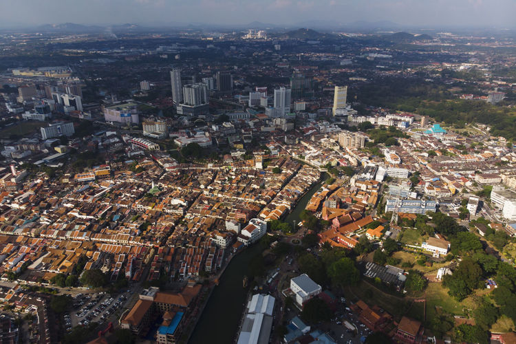 Aerial view of Melaka (Malacca) historic colonial town around Malacca river in Malaysia. DJI Mavic Air Melaka Shadow And Light UNESCO World Heritage Site Aerial View Architecture Building Built Structure City Life Cityscape Community Culture Day Dji High Angle View Historical City Local Community Malacca Malaysia Residential District Sky Skyscraper Sun Tourism Unesco