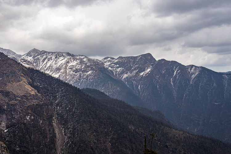 Himalayan mountains covered with light snow at evening