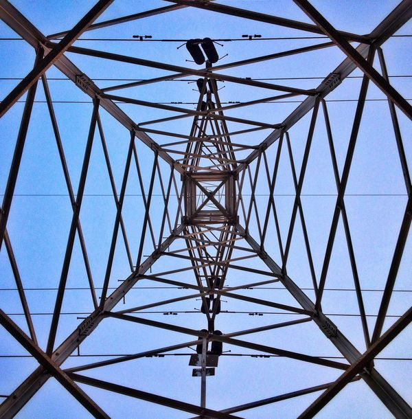 Patterns in the sky Cable Connection Day Electricity  Electricity Pylon Global Communications Low Angle View No People Outdoors Pattern Power Line  Power Supply Shotonphone Sky Technology Tower