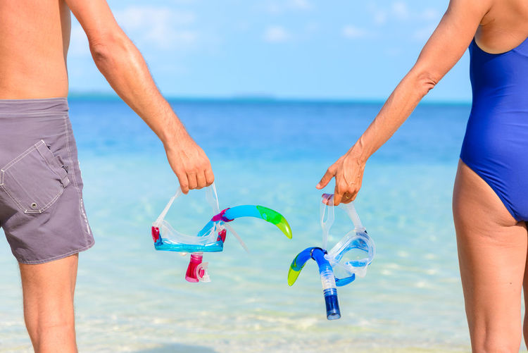 Water Real People Leisure Activity Sea Lifestyles Land Two People Nature Beach Sky Horizon Over Water Horizon Human Body Part Day Togetherness Scenics - Nature Men People Beauty In Nature Body Part Outdoors