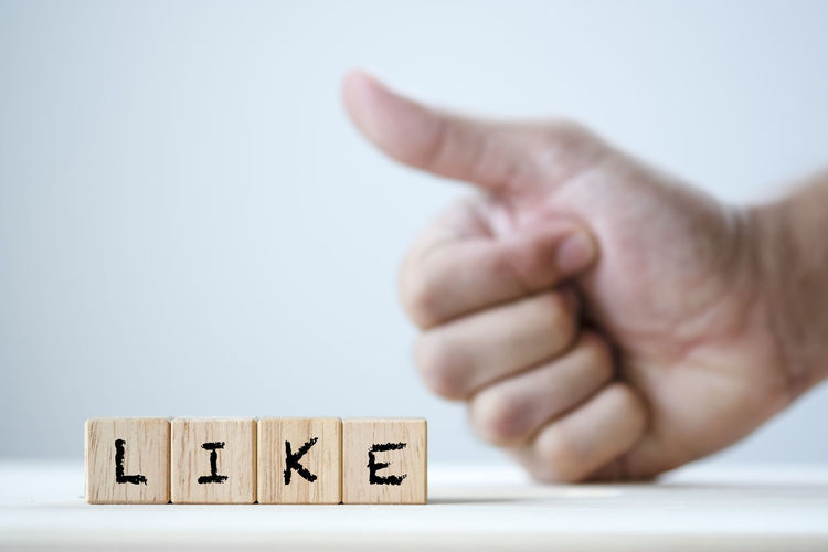 Like keyword on wooden cubic and fist showing thumb up gesture.-Image Business Click Commerce Communication Computer Concept Creativity Design Digital Download E-mail Engine Finger Follower Friend Gesture Hand Human Icon Idea Internet Keyword Letter Like LINE Link Love Marketing Network Online  Palm People Positive Set Share Showing Sign Social Strategy Success Symbol Tag Teamwork Technology Text Thumb User Web Website Word