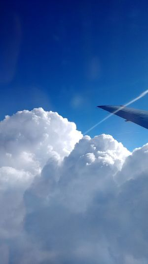 Airplane Airplane Wing Beauty In Nature Blue Cloud - Sky Cloudscape Day Flying Journey Nature No People Outdoors Scenics Sky Sky Only Transportation Travel White