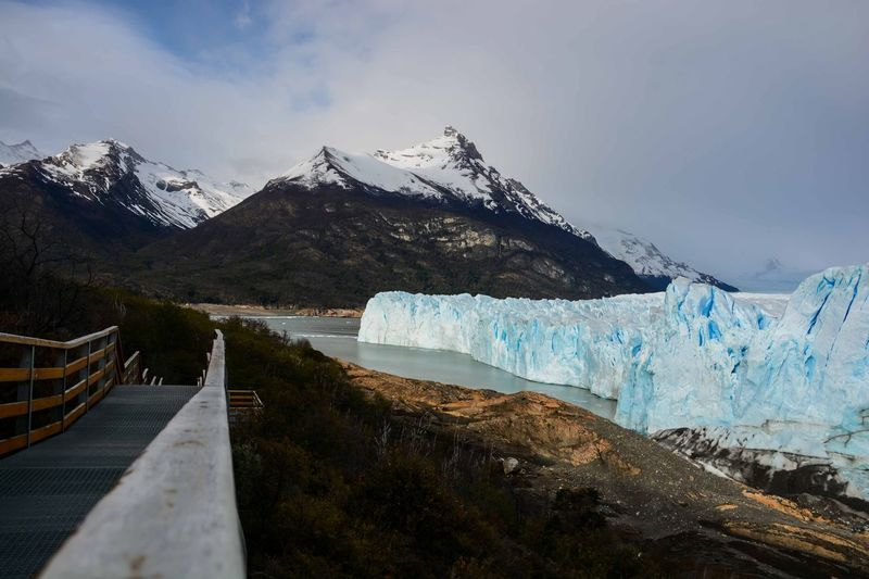 Moreno Glacier With Snowcapped Mountains In Background