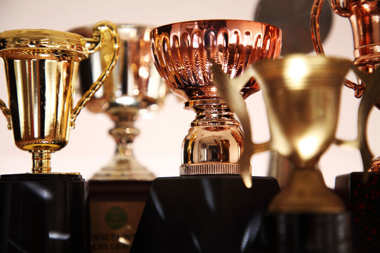Close-up of trophies against wall