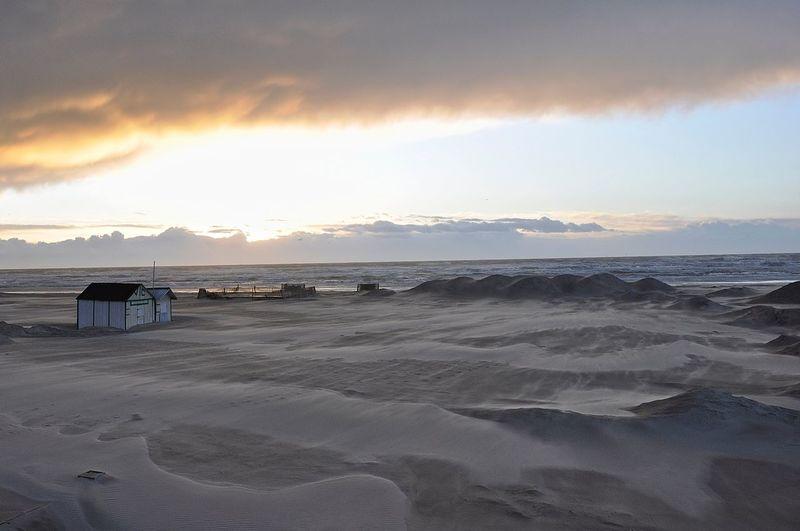 View of calm beach against the sky