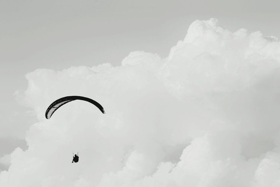 Adventure Blackandwhite Cloud - Sky Cloudscape Minimalism Outdoors Paragliding Parasailing Raglan Recreational Pursuit Silhouette Tranquil Scene Monochrome Photography