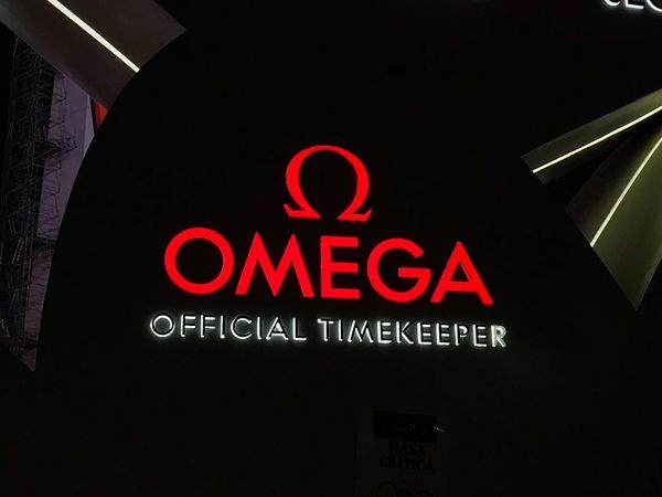 Omega brand Omega Watches Text Communication Illuminated Western Script Night Sign Neon Dark Lighting Equipment Close-up Indoors  Capital Letter Information Sign Information Low Angle View Red No People Glowing Architecture Built Structure