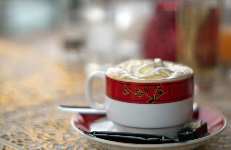 Close-up Coffee Coffee - Drink Coffee Cup Crockery Cup Drink Focus On Foreground Food And Drink Freshness Hot Drink Indoors  Kitchen Utensil Mug No People Non-alcoholic Beverage Red Refreshment Saucer Selective Focus Still Life Table Tea Cup