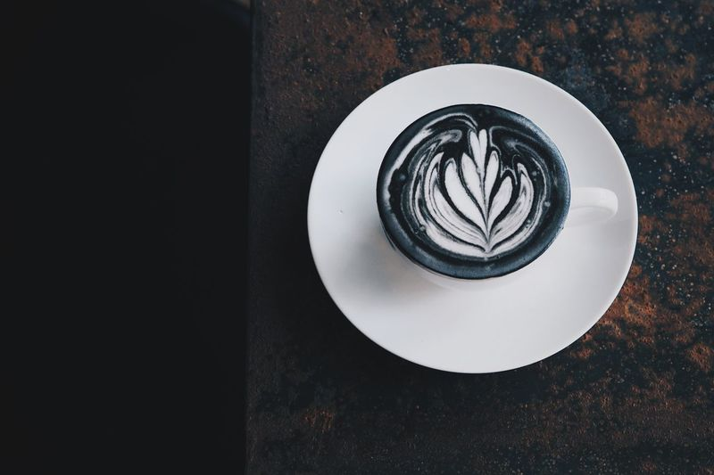 coffee charcoal on wooden table in coffee shop Cappuccino Close-up Coffee - Drink Coffee Cup Day Directly Above Drink Food And Drink Freshness Froth Art Frothy Drink High Angle View Indoors  Latte No People Plate Refreshment Saucer Still Life Table