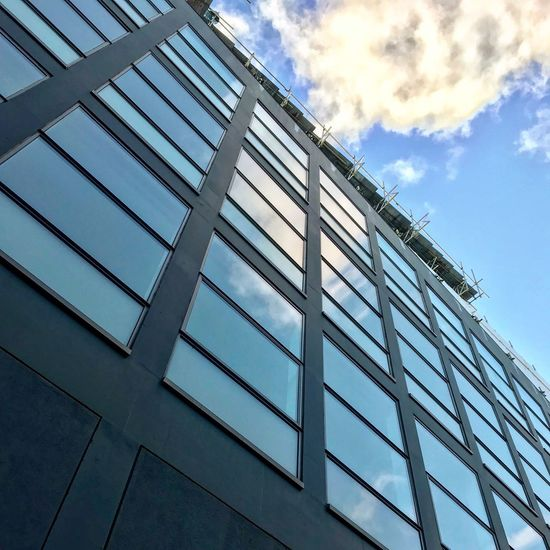 Building Exterior Architecture Built Structure Sky Window Low Angle View Cloud - Sky Day Outdoors No People Modern