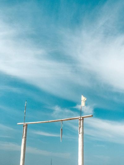 Low angle view of pole against blue sky
