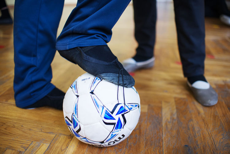 Ball Body Part Dancer Flooring Human Body Part Human Foot Human Leg Indoors  Lifestyles Low Section Real People Shoe Sport Sports Equipment Team Sport Wood World Cup 2018