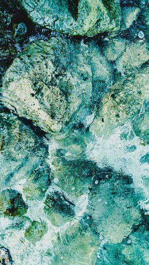 Full frame shot of blue water on rock