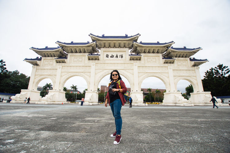 Woman in front of historical building
