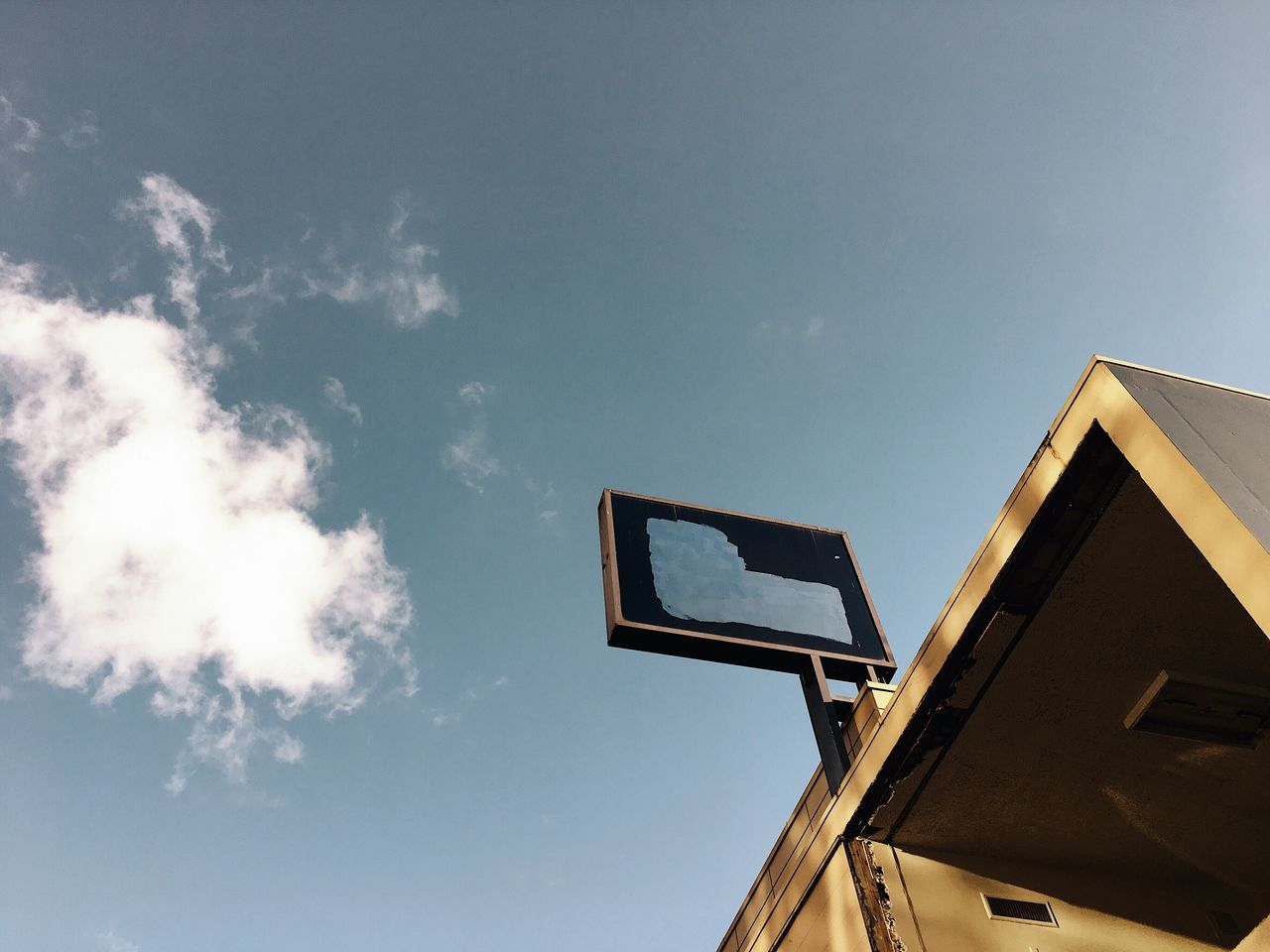 low angle view, sky, built structure, cloud - sky, day, outdoors, no people, communication, building exterior, architecture