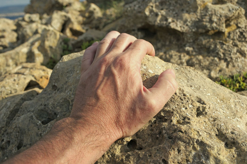 climbing up a rock Activity Arm Climbing Close-up Closeup Day Grabbing Grasping Grip Hand Holding Human Hand Male Man Nature One Person Outdoors People Reach Reaching Rock Rocks Rocky Safe Strenght