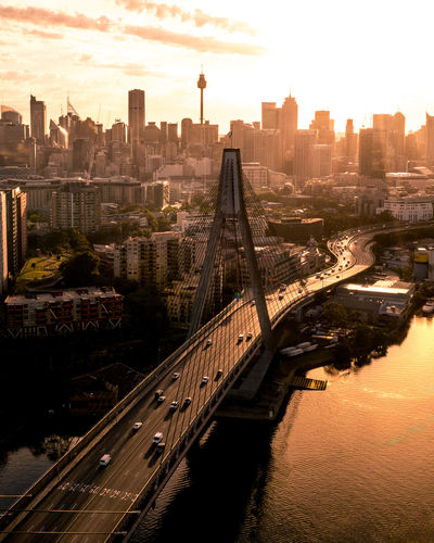 The morning glow over a stunning city skyline Built Structure Architecture Building Exterior City Transportation Cityscape Sky Bridge Building Connection Bridge - Man Made Structure Travel Destinations River Office Building Exterior Skyscraper Cloud - Sky Nature Water Tall - High No People Outdoors Modern Aerial View Drone  EyeEm Best Shots