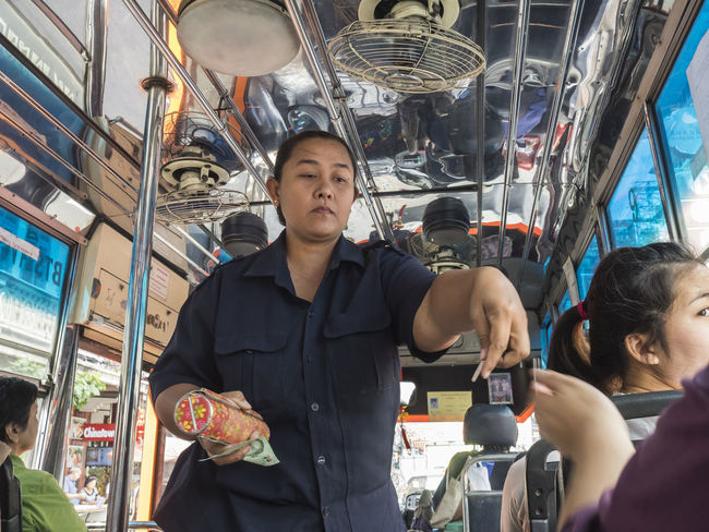 ASIA Bangkok Bus Casual Casual Clothing Cultures Daily Life Day Documentary Lifestyles On The Way Ordinary  People Portrait Selling Shiny Street Streetphotography Thailand Thailand_allshots Tickets Travel Traveling Woman Working