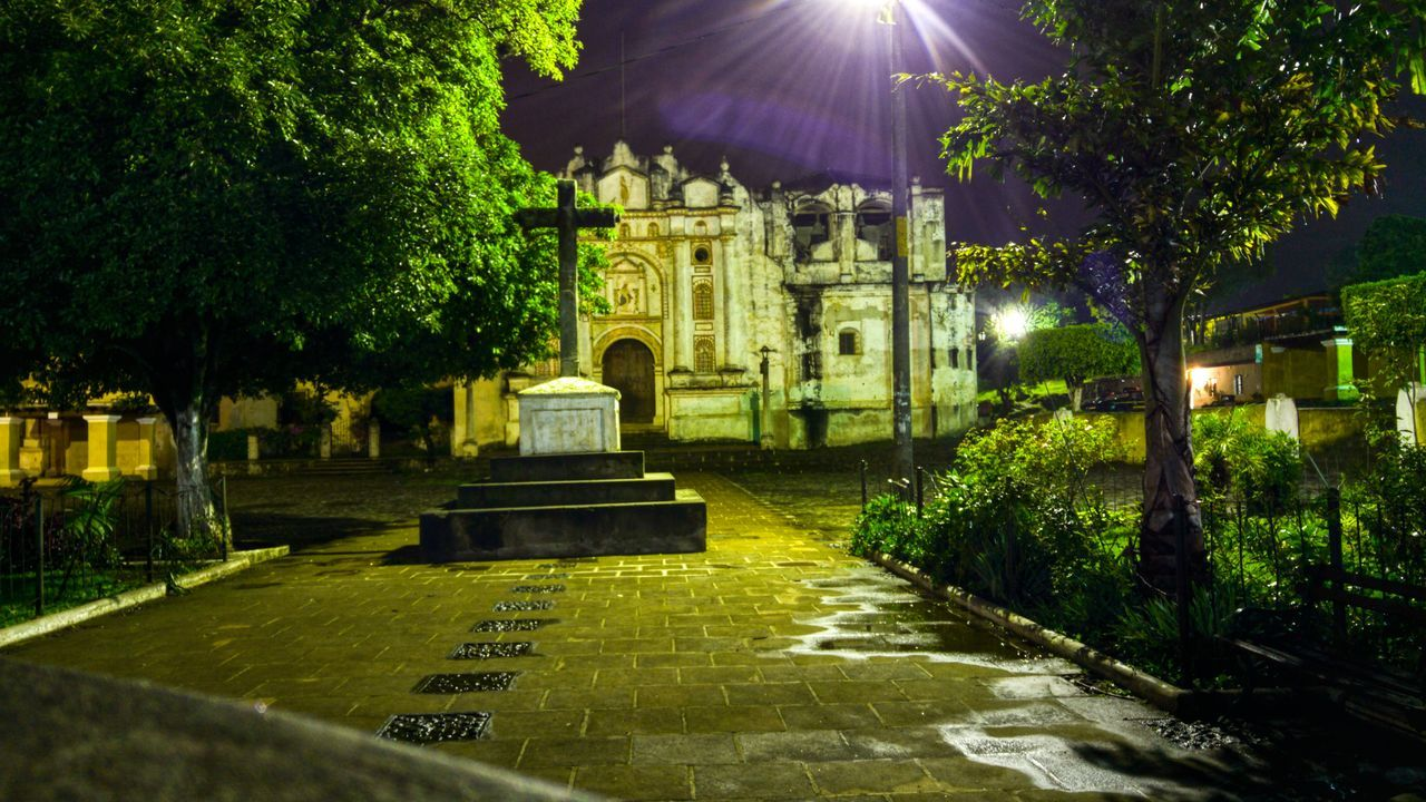 cemetery, built structure, architecture, tree, outdoors, no people, memorial, illuminated, building exterior, night, gravestone, nature, sky