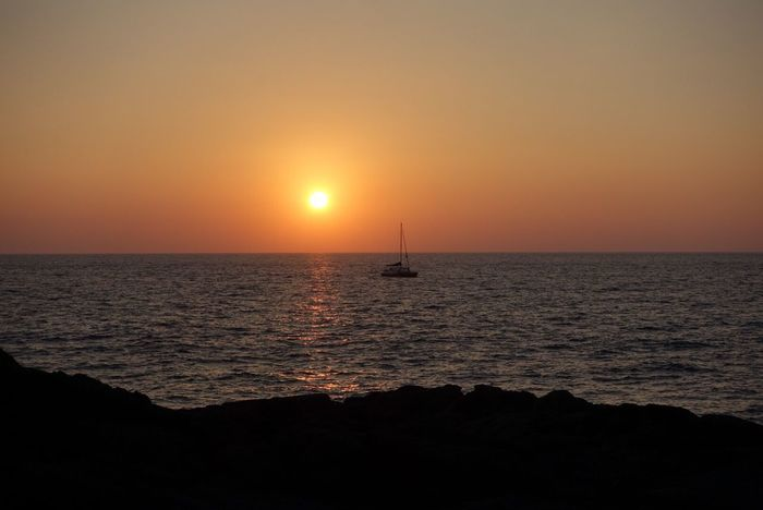 Sunset Sea Horizon Over Water Scenics Beauty In Nature Nature Sun Water Tranquil Scene Silhouette Orange Color Tranquility Idyllic Sky Nautical Vessel Sailboat No People Waterfront Outdoors Sunlight Hawaii
