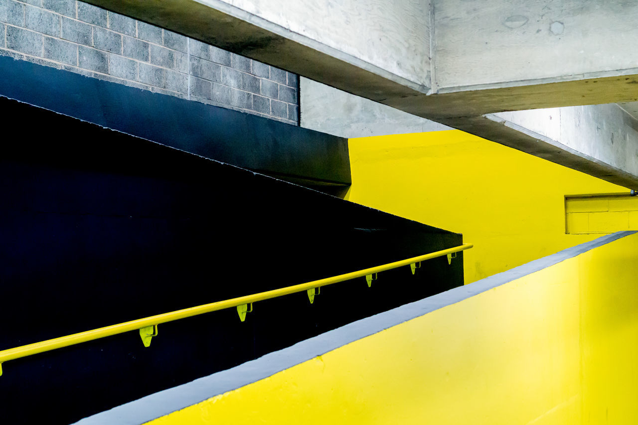Low Angle View Of Black And Yellow Wall