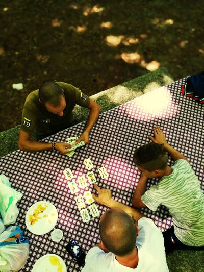 High angle view of people sitting in plate
