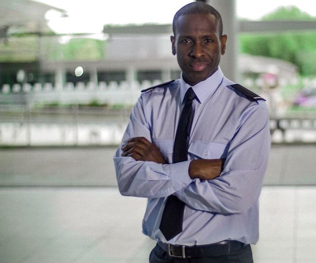 Generic Black male security officer with folded arms. Security Officer Actor Folded Arms Black Male