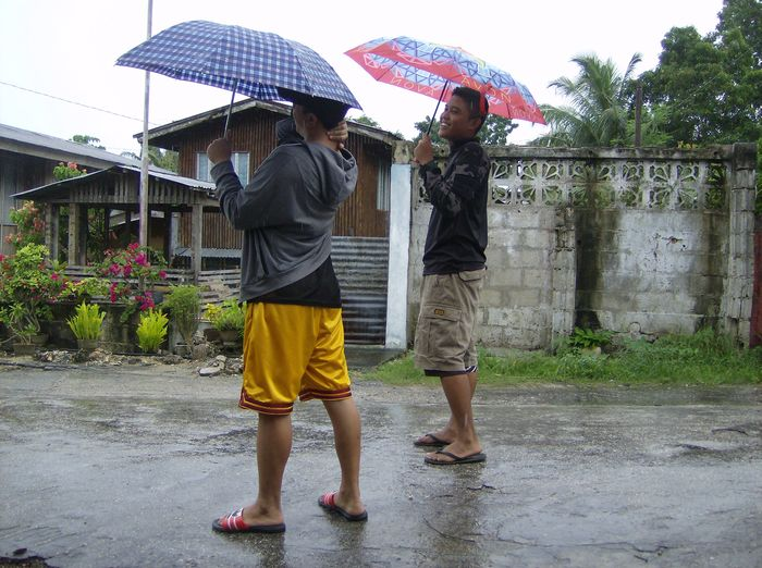 My neighbors Renz and Patrick. They are living next door as boarders. They are schooling here in Siquijor Philippines. Its raining heavily and a storm expecting to hit our country. No school all levels. EyeEmNewHere Two People Rain Wet Togetherness Full Length Water Day Outdoors Friendship Enjoying The Moment EyeEmMagazine Eduardocabo Streetphotography Siquijorisland Luvuhuneko2074 Shiela2074 Stormy Sky Urban Photography Young Adult