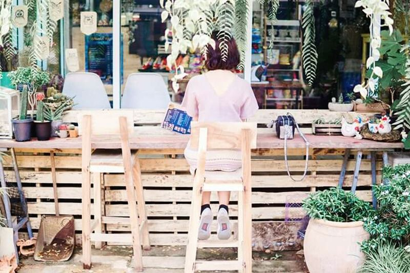 Day Lifestyles Sitting Outdoors One Person People Back Coffee Shop Furnitures Tree Garden Girl Shorthair Sneakers