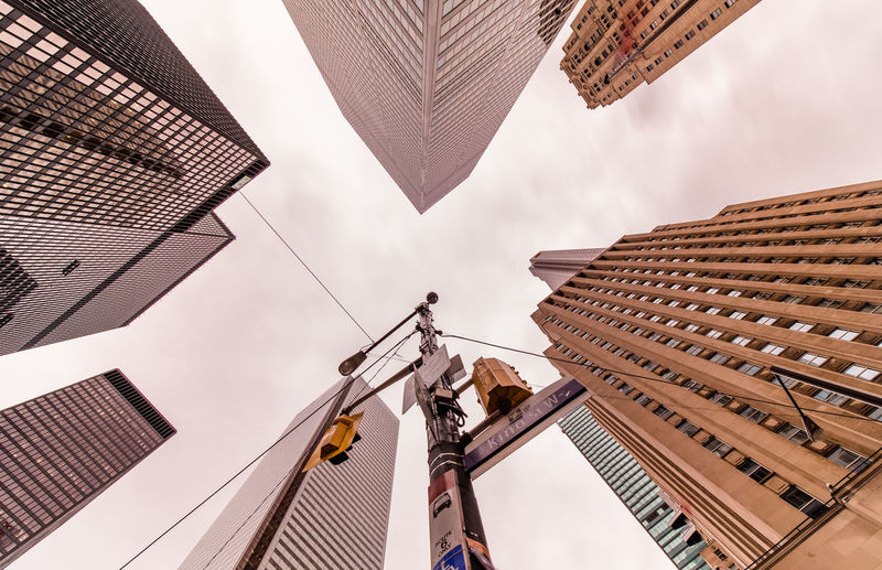 Low angle view of tall buildings against sky