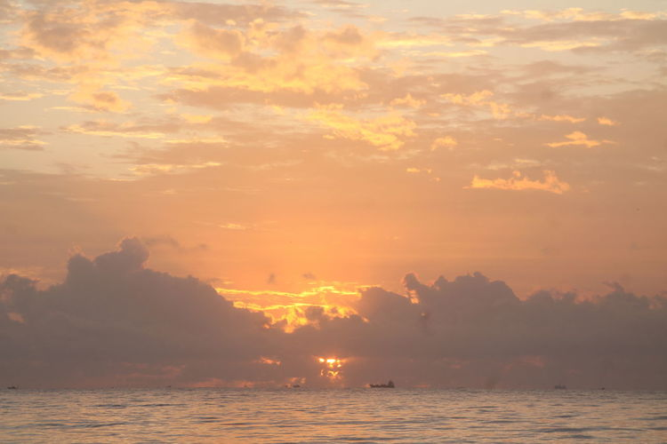 Sunrise at Manggar Beach Sky Sunset Beauty In Nature Water Tranquility Sea Cloud - Sky Scenics - Nature Orange Color Tranquil Scene Nature Waterfront No People Idyllic Outdoors Horizon Sun Horizon Over Water Environment Beach Sunrise View Landscape Sunlight Dusk