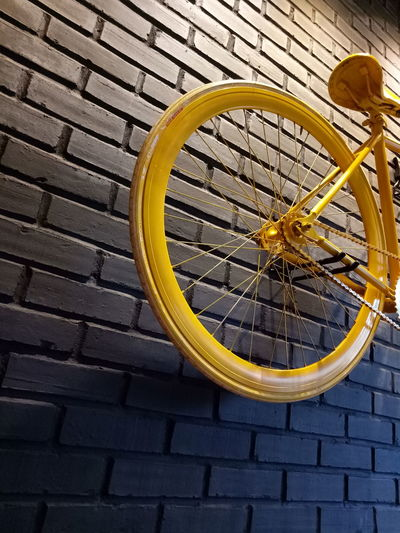 Black brickwall with Yellow bicycle feature, a nice corner in warunk Upnormal Wall Wall Art Yellow Brick Wall Black Cafe Wall Feature Background Bicycle Bicycle Rack Wheel No People Interior Restaurant Restaurant Decor Decoration Decor Unique Unique Art First Eyeem Photo EyeEmNewHere