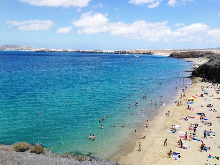 Playa Papagayo | Lanzarote Beach Sand Sea Vacations Tourism Water Summer Travel Destinations Outdoors Sunny Nature Idyllic Day Large Group Of People High Angle View Beauty In Nature Scenics Cloud - Sky Landscape View Eyem Collection Eyem Market Eyem City Shots Eyem Gallery Eyem Best Edits Breathing Space