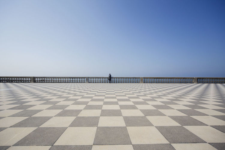 Checked Pattern Clear Sky Copy Space Sky Pattern Blue Day Flooring Nature Architecture Horizon Sea Horizon Over Water Men Water One Person One Person Watching Leisure Activity Lifestyles Livorno Livorno Italy Piazza Mascagni