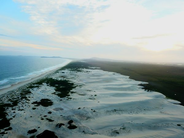 sand dunes at sunset Drone  Beach Sea Water Sand Horizon Over Water Tranquility Beauty In Nature Outdoors Tranquil Scene Sunset Cloud - Sky Sky Day Wave No People