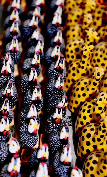 Full Frame Shot Of Toy Hens And Giraffes At Market