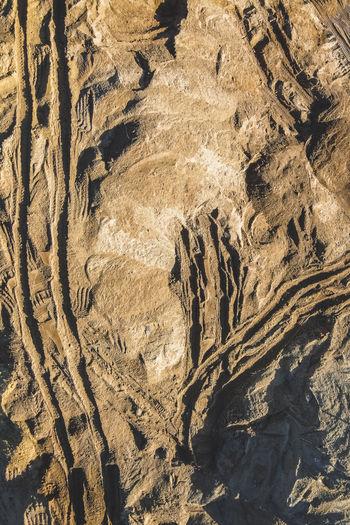 Full frame shot of rocks on sand