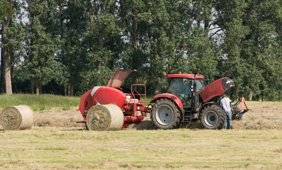 Round baler in haymaking Agriculture August Autumn Cut Cutting Farm Farmland Grass Industrial Industry Nature Round Baler Rural Straw Bale Tractor Agricultural Services Equipment Fields Harvest Harvesting Hay Hay Balers Peasant Farming Tractors Working Tool