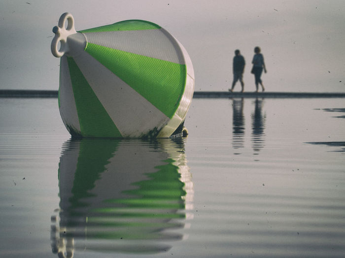 Close-Up Of Buoy On Water At Beach