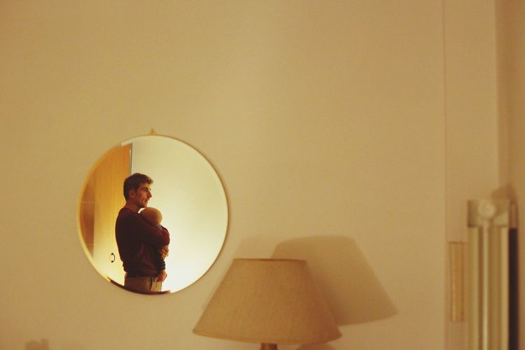 Young woman on mirror at home