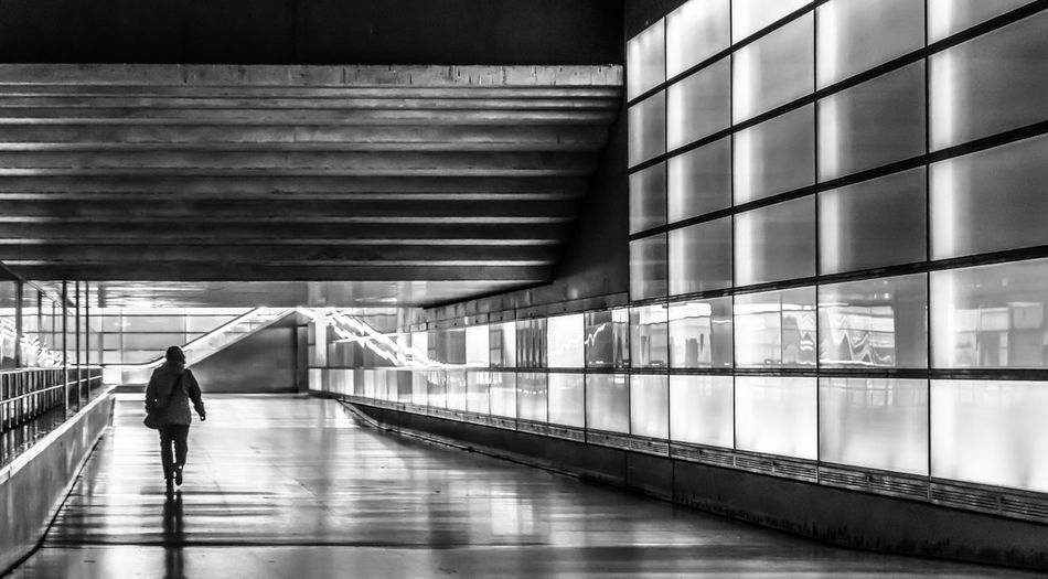 Architecture Reflection Motion Real People Men Modern Walking Blackandwhite Black And White Travel Illuminated Potsdamer Platz Transportation Railing Direction Indoors  Futuristic Adult Lifestyles Moving Walkway  Full Length Berlin Photography One Person The Way Forward Leisure Activity Built Structure Underground Walkway Krull&Krull Black And White Capture Tomorrow Humanity Meets Technology Indoors  Moving Walkway  Krull&Krull Architecture